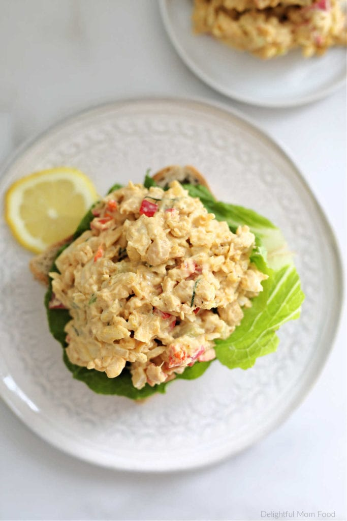 vegan tuna salad made with chickpeas on a slice of bread with lettuce