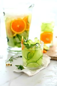 Enjoy this refreshing cucumber water recipe infused with fresh orange slices, mint and lime to increase hydration, absorption of immunity boosting vitamin C, and to achieve a vibrant complexion! It is easy to make and sip all day! #detox #water #recipe #cucumberwater #cucumberlimewater #orangecucumberwater #watercleanse #waterflush #cucumber #beverage #drink | Recipe at Delightful Mom Food