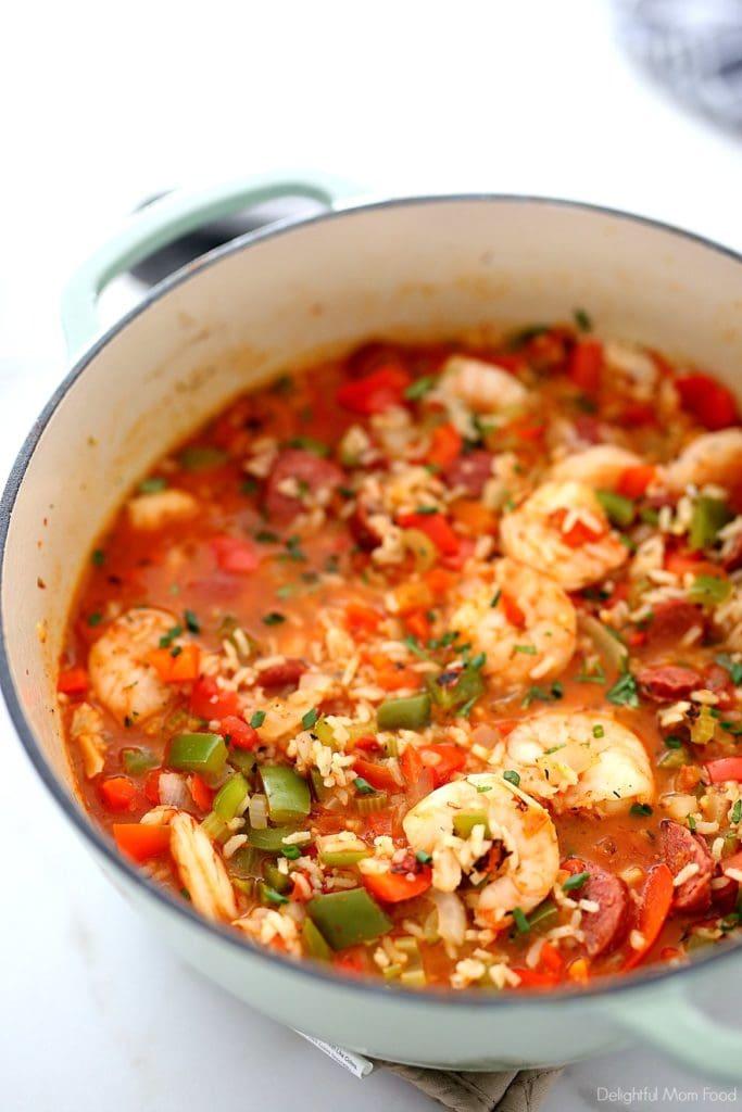 cajun jambalaya recipe in a teal cast iron pot