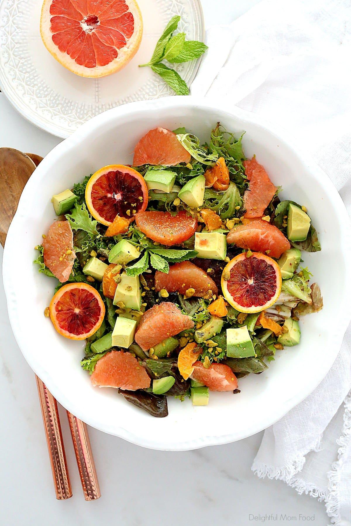 oranges, grapefruit, avocado in a salad