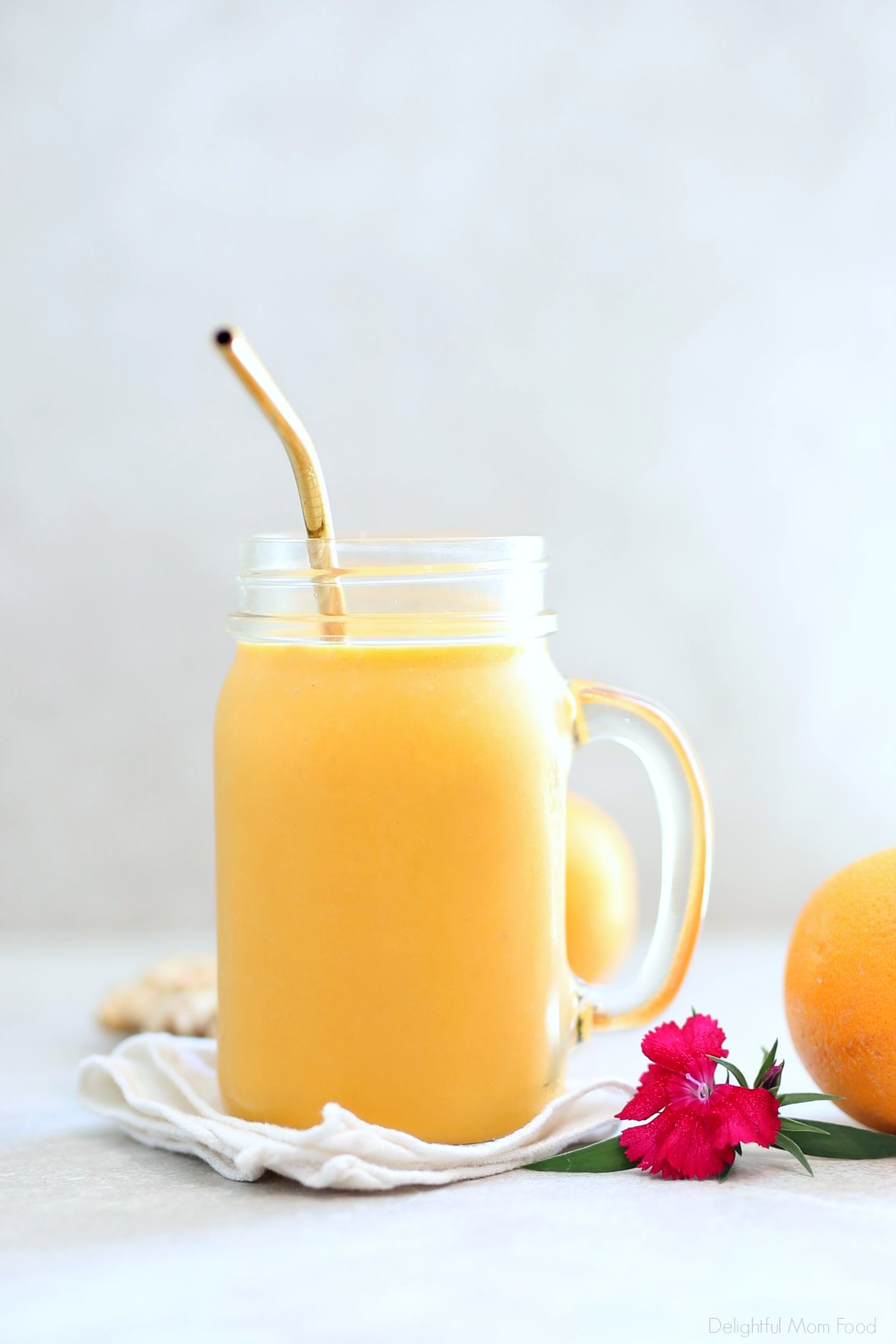 Anti inflammatory smoothie loaded with immunity boosting nutrients from carrot, ginger and turmeric! Reduce inflammation, support healthy joints, eyes, skin, hair, heart, mood and more with this tasty smoothie recipe. #gingerturmericsmoothie #gingersmoothie #turmericsmoothie #vegan #anti-inflammatory #reduceinflammation #recipe #smoothie #vegetarian #dairyfree #glutenfree #orangesmoothie #delightfulmomfood | Recipe at Delightful Mom Food