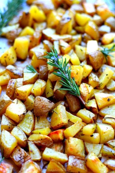 rosemary potatoes roasted in the oven with fresh rosemary