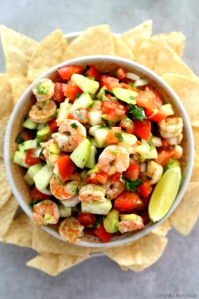 shrimp ceviche served in a bowl with chips