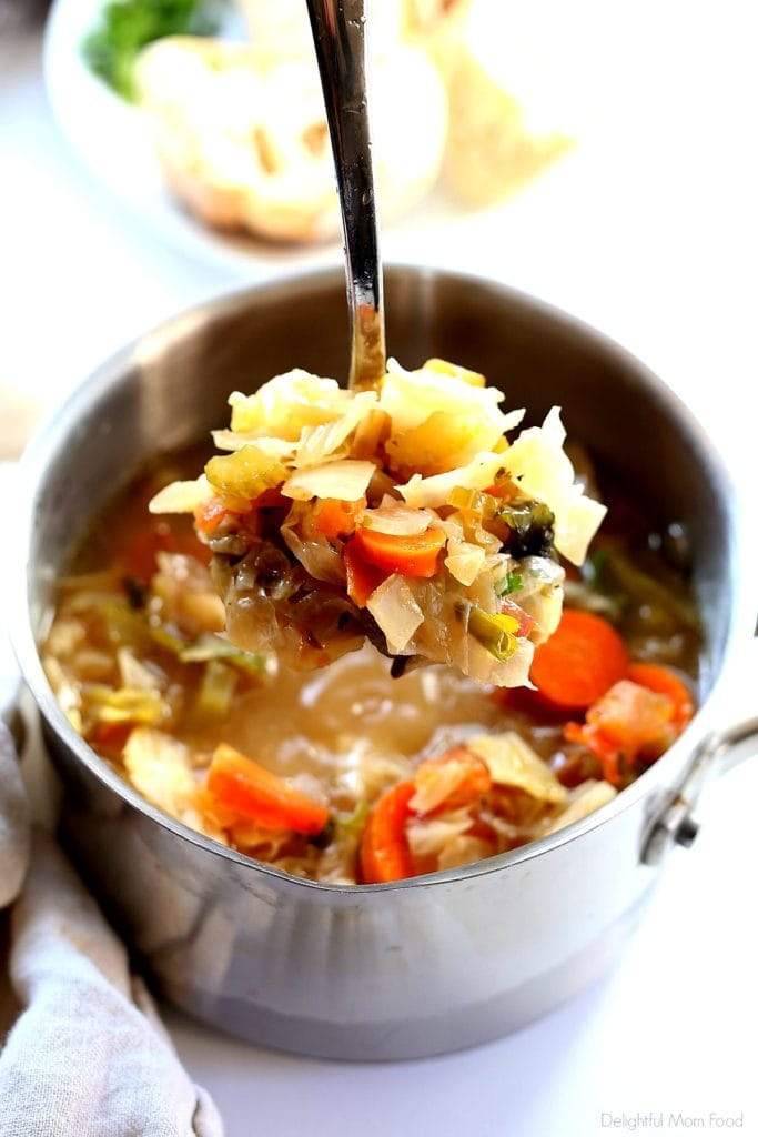 Spoonful of detox cabbage soup in miso broth to support weight loss