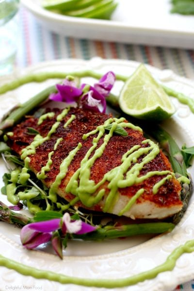 baked rockfish recipe with blackened seasoning and avocado fish taco sauce on top