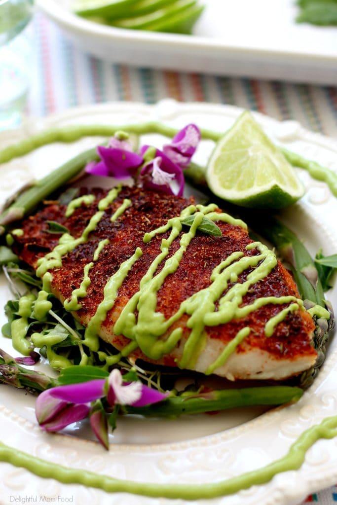 baked rockfish recipe with blackened seasoning and avocado fish taco sauce on top