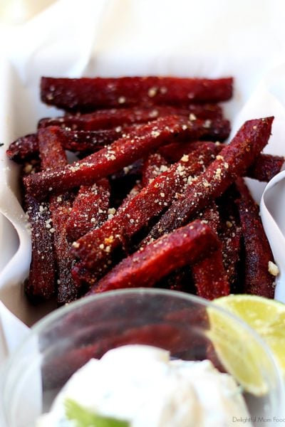 roasted beet fries on a dish with yogurt dip
