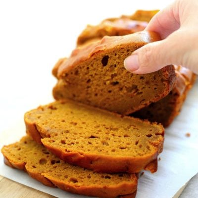 picking up slices of gluten free pumpkin bread