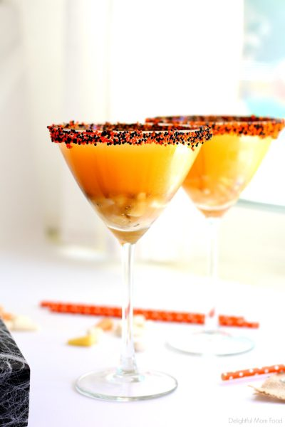 Candy corn martini recipe served in two martini glasses