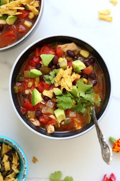 healthy chicken tortilla soup recipe in a bowl with a spoon