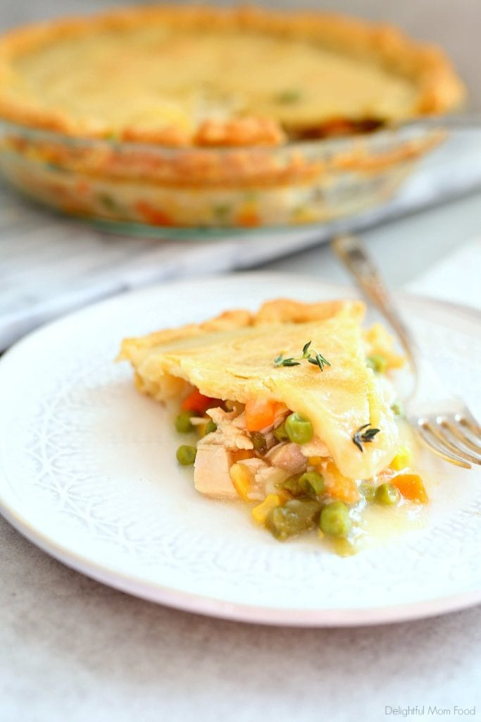 best slice of pot pie with a gluten-free crust and fresh thyme on top