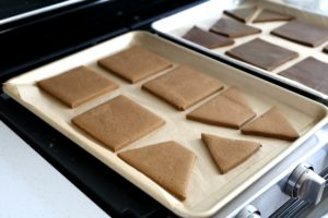 baked gluten-free gingerbread cookie pieces for a house