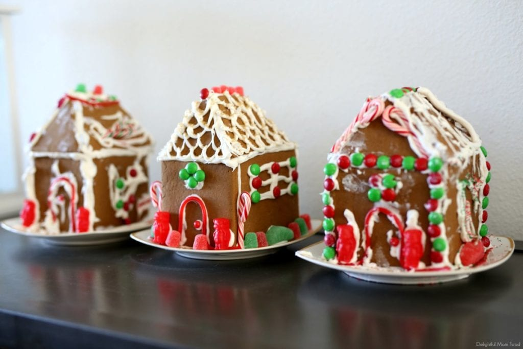 three decorated homemade gingerbread houses
