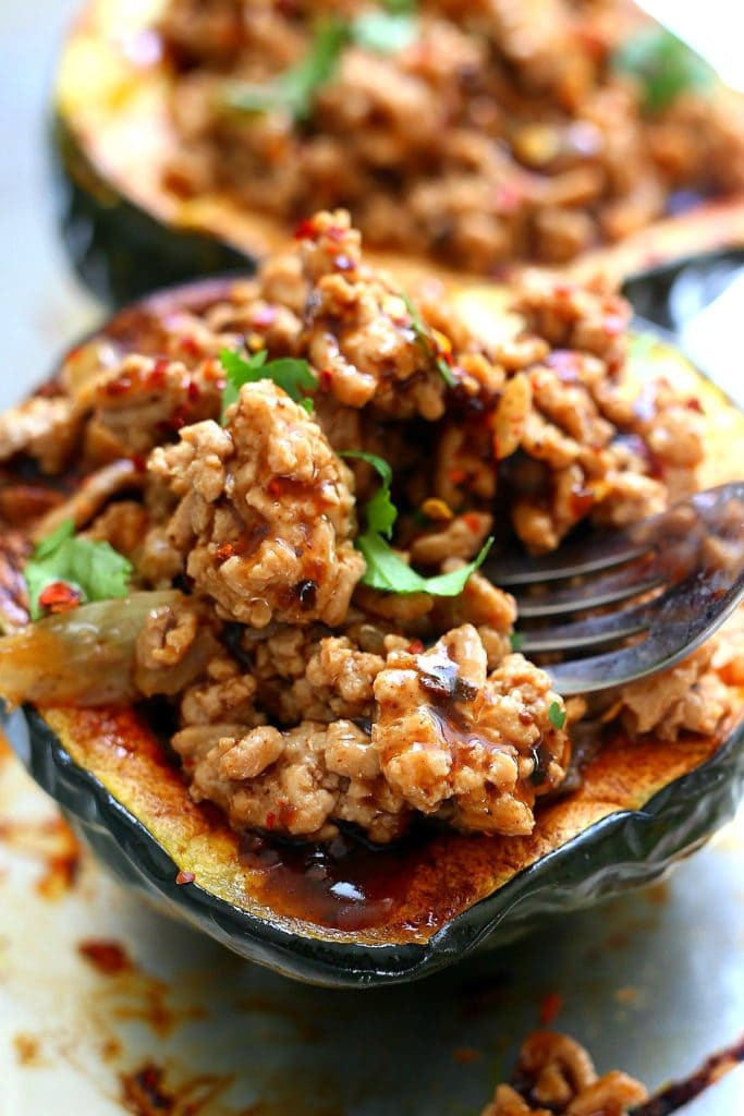 acorn stuffed squash filled with ground turkey meat in Korean BBQ sauce
