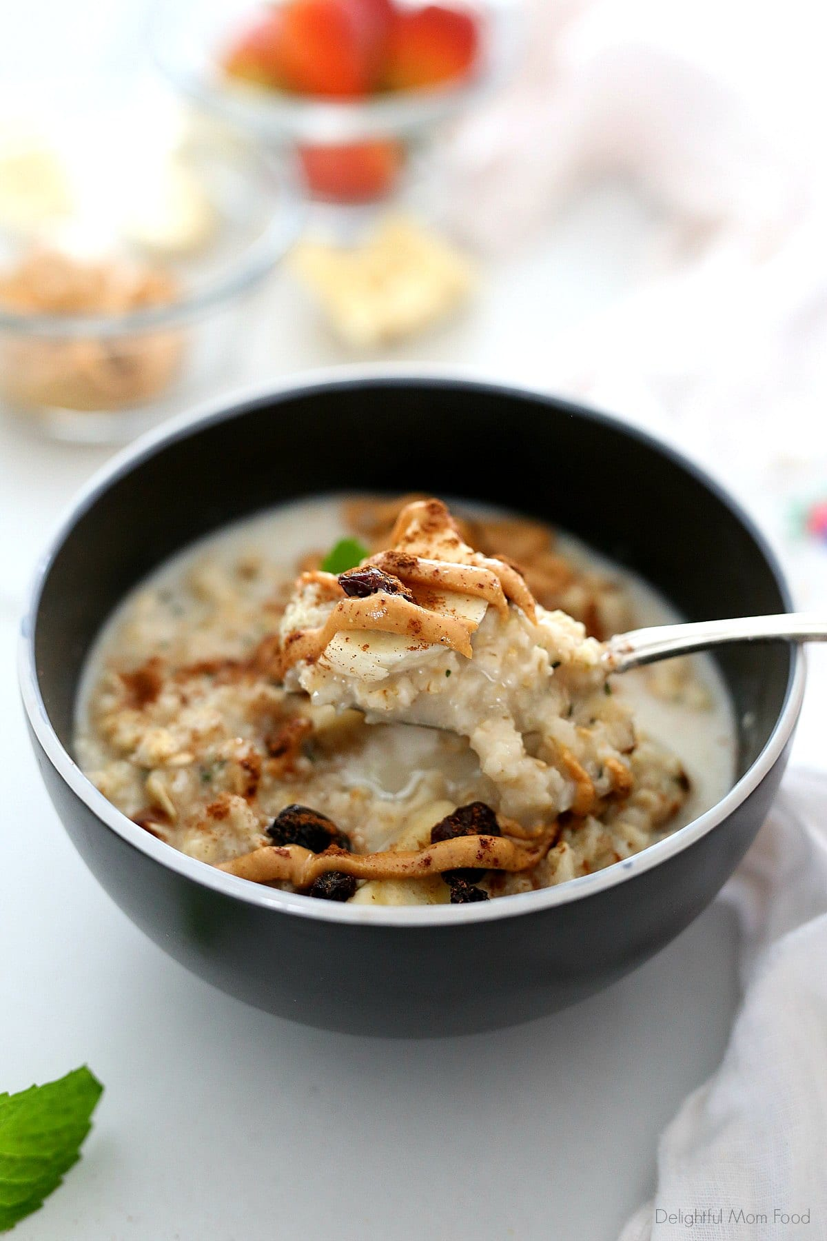 scooping a bowl of peanut butter oatmeal with a spoon