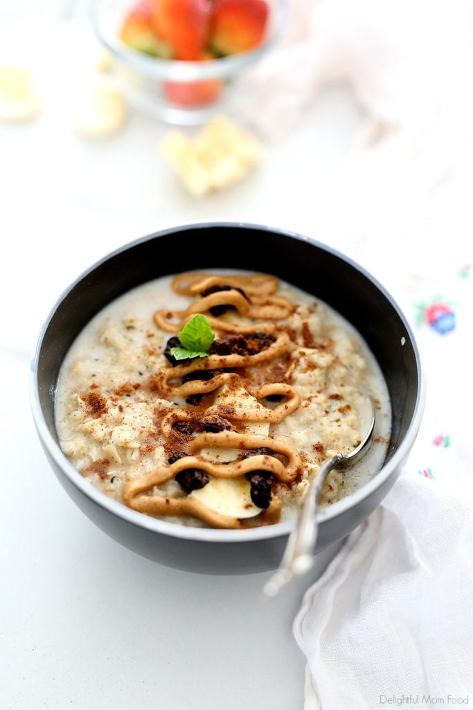 bowl of peanut butter oatmeal with banana slices, raisins and cinnamon