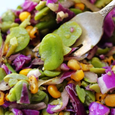 fava bean salad recipe being scooped with a fork from a bowl