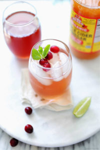cranberry juice detox water beverage with apple cider vinegar and lime
