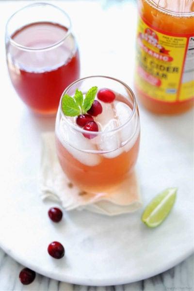 cranberry juice detox water beverage with apple cider vinegar and lime