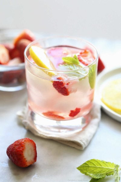 strawberry, lemon, mint infused into a detox water drink served in a glass