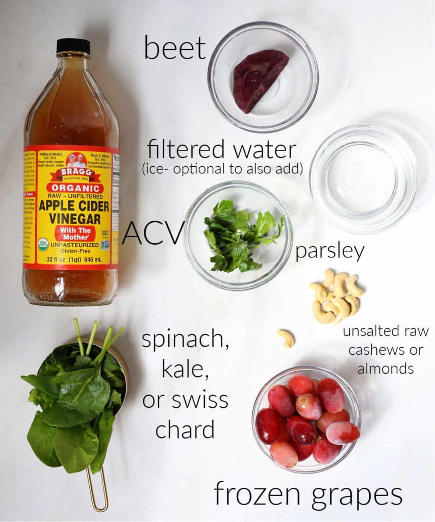 apple cider vinegar spinach grapes beets and all ingredients that go into an apple cider vinegar smoothie drink