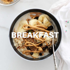 bowl of peanut butter oatmeal with raisins and banana slices