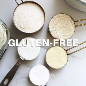 various gluten free flours in measuring cups