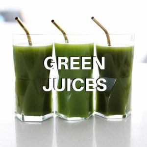 homemade green juice in three glasses with gold straws