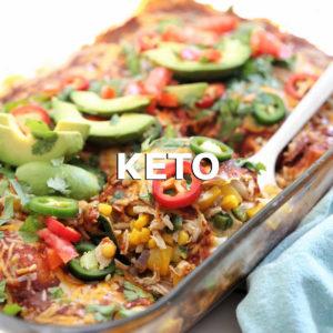 spatula serving Keto chicken enchiladas casserole from a casserole dish