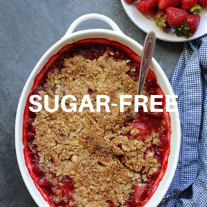 sugar free strawberry crisp in a baking dish with a spoon