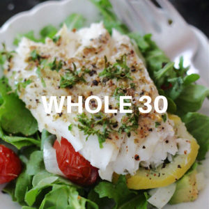 baked cod fish over salad greens