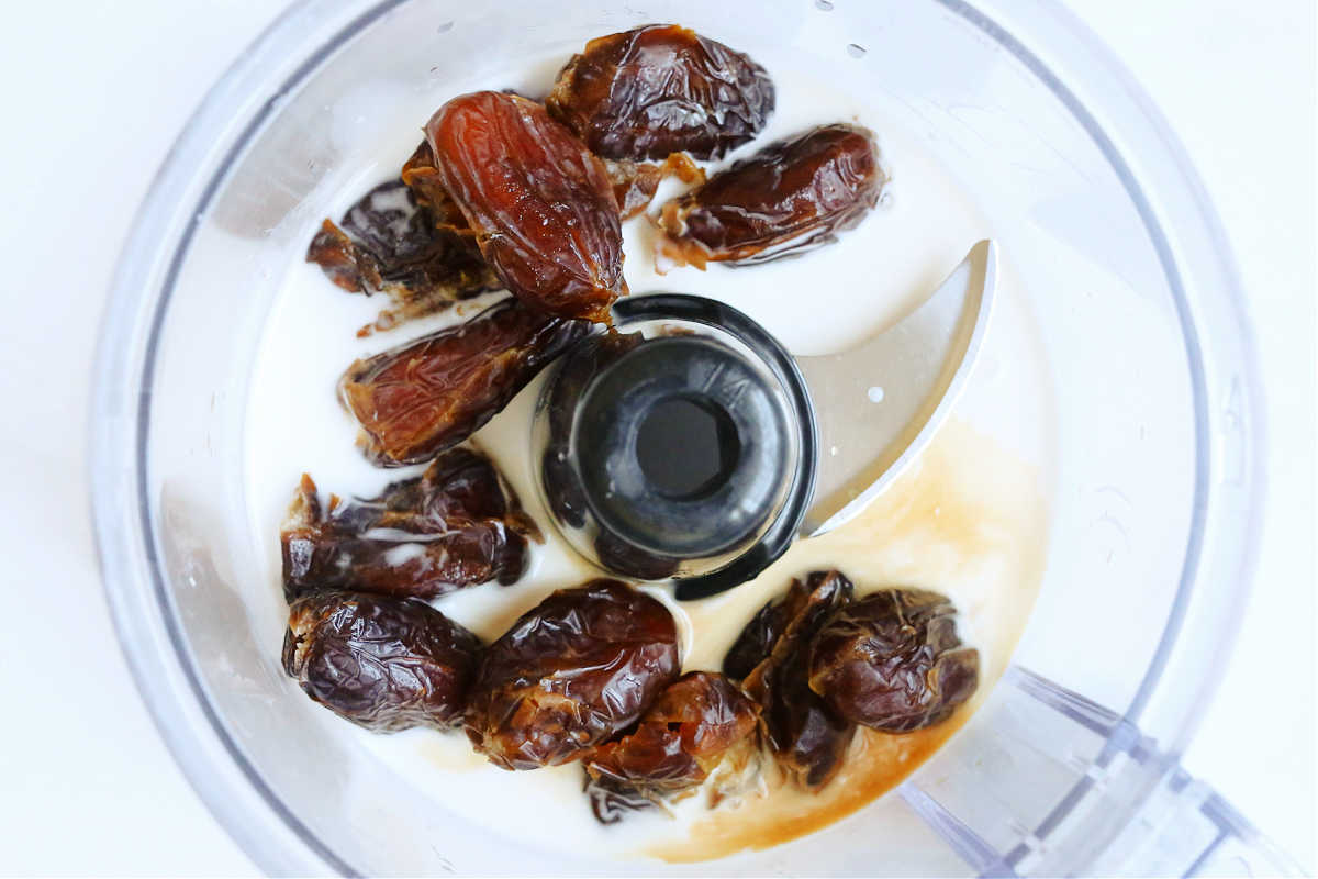 pitted dry medjool dates coconut cream vanilla and salt in a food processor