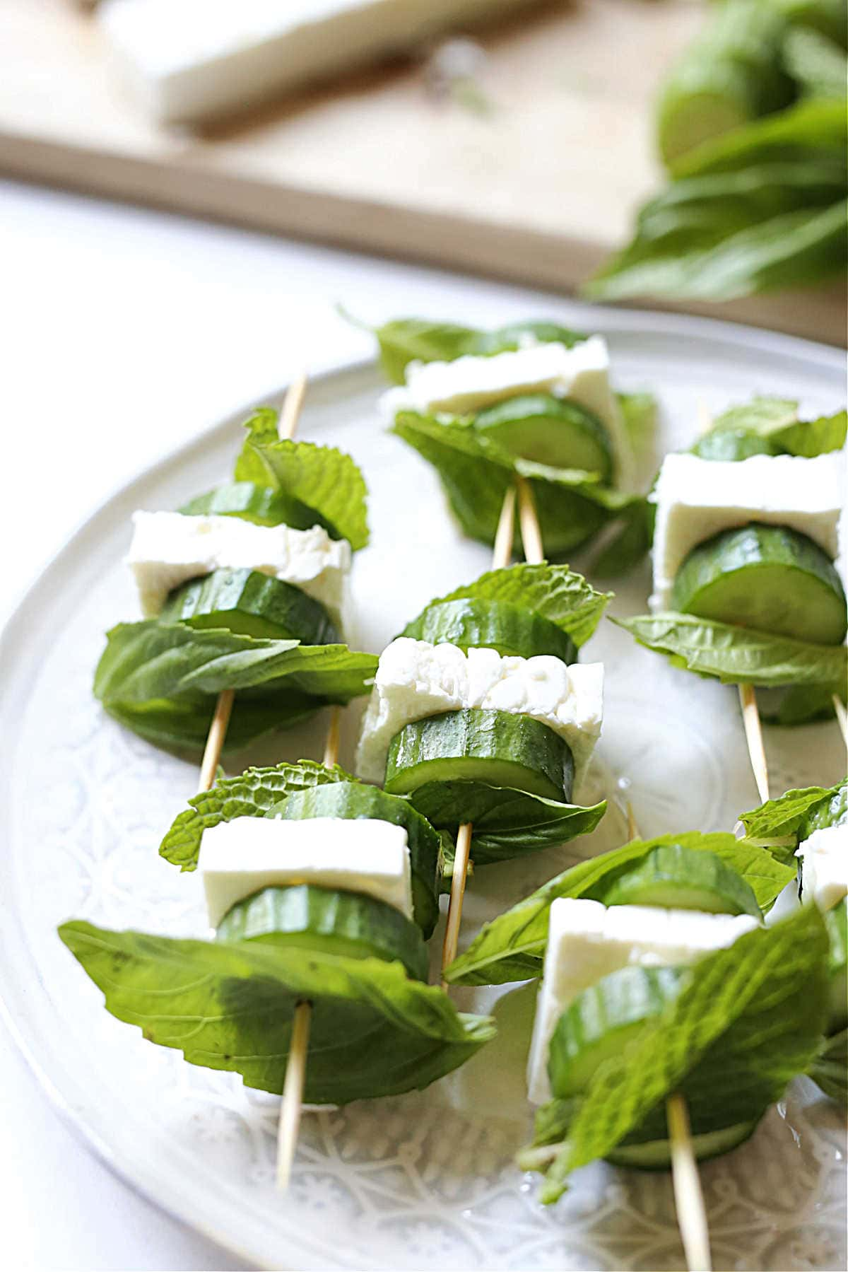 cucumber feta and herbs on toothpicks served as an appetizer bites