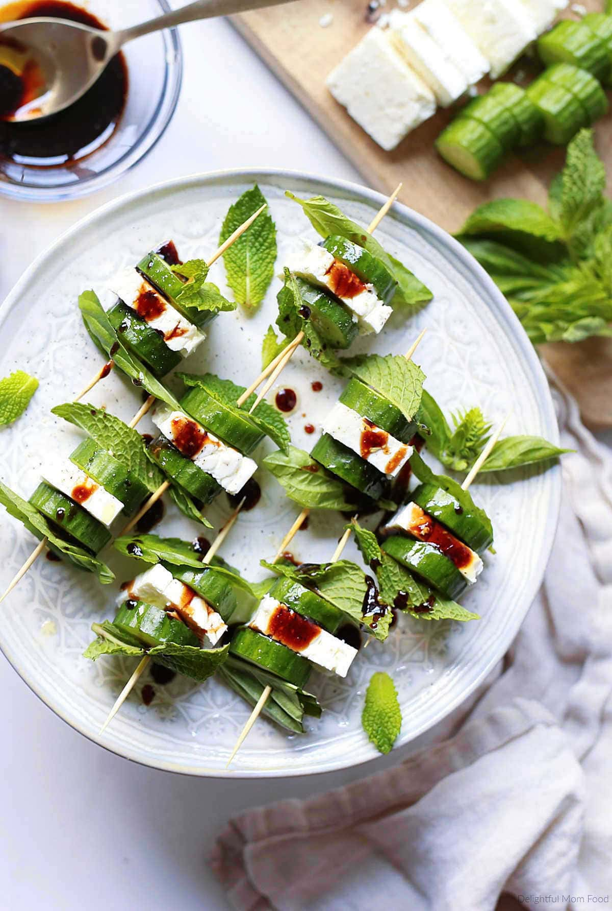 feta cheese and cucumber bites served on toothpicks as an appetizer