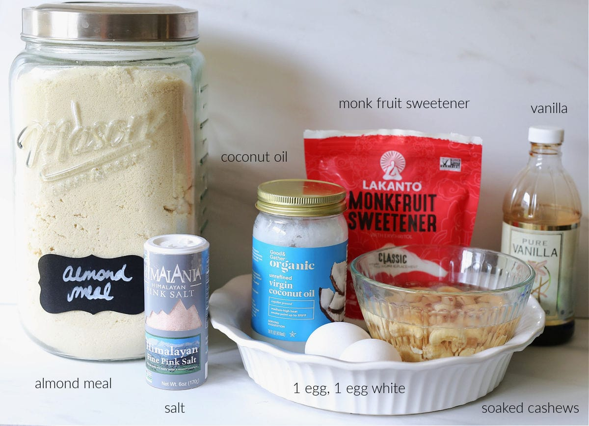 ingredients for paleo pie including almond meal, cashews, vanilla, salt, eggs, coconut oil, and sweetener