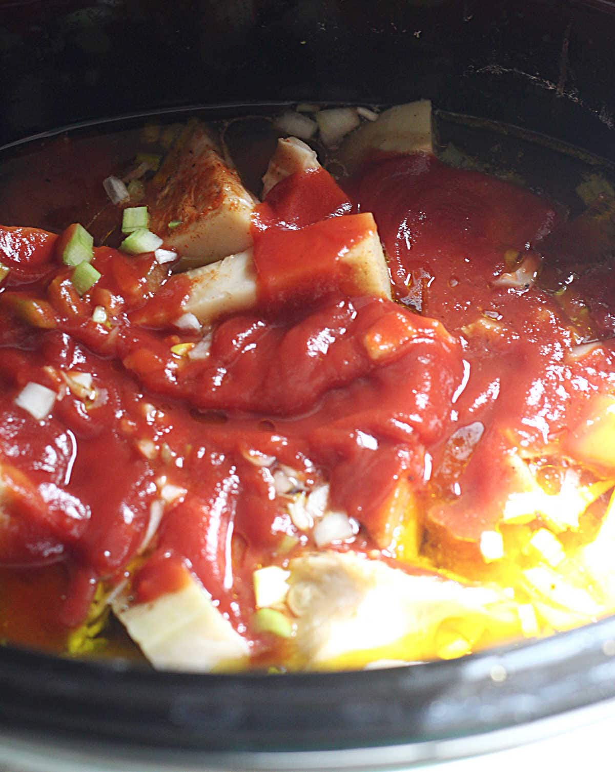 young jackfruit with gluten free barbeque sauce ingredients in a slow cooker to make vegan jackfruit pulled pork