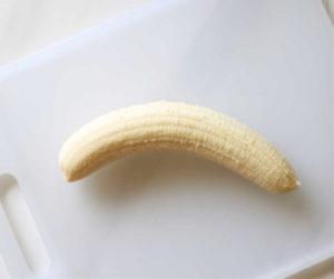 peeled banana on a cutting board