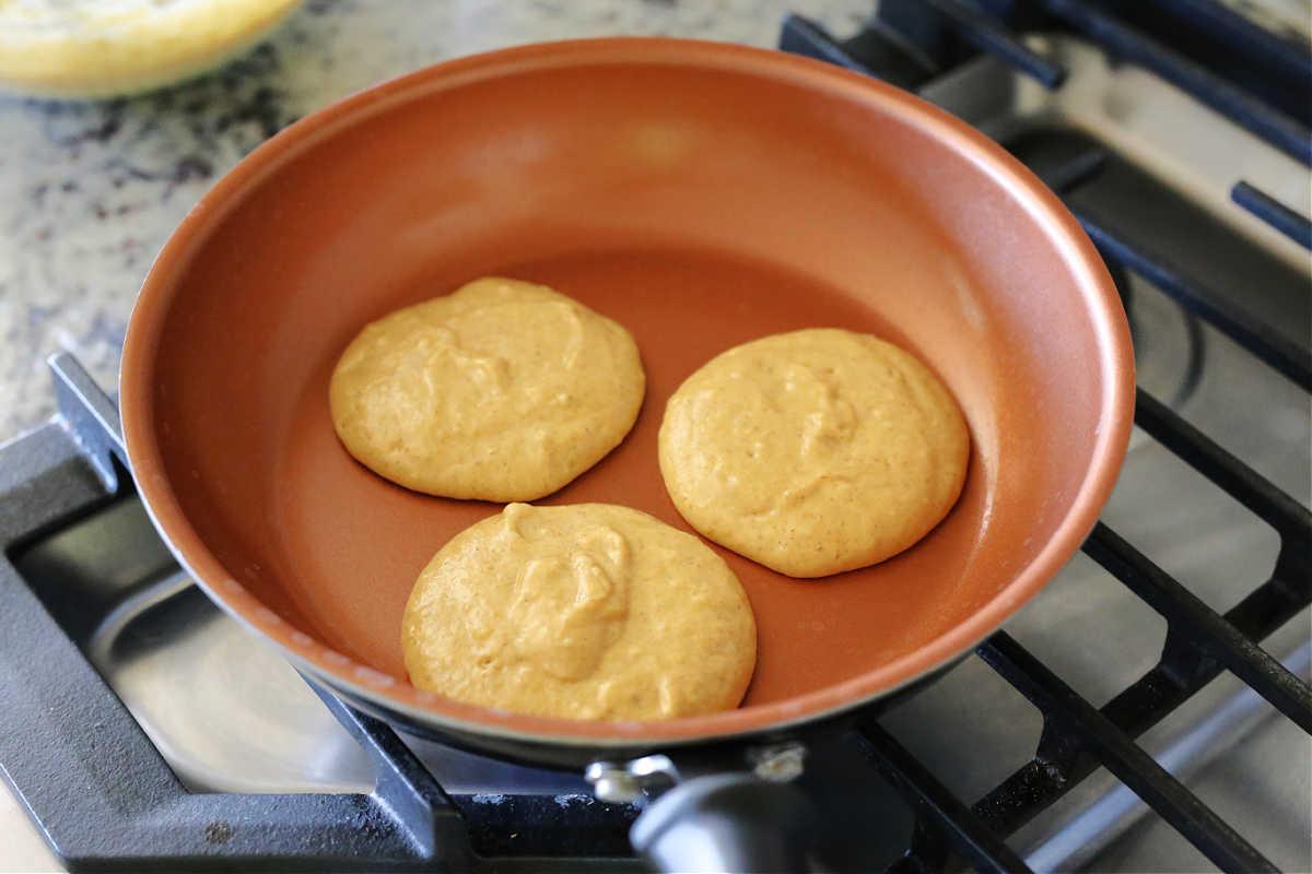 pumpkin pancake batter cooking on the stove top